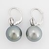 Cultured tahiti pearl and diamond earrings.