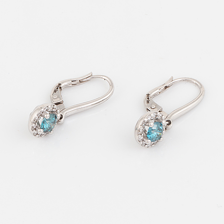 Brilliant-cut colourtreated blue diamond earrings.