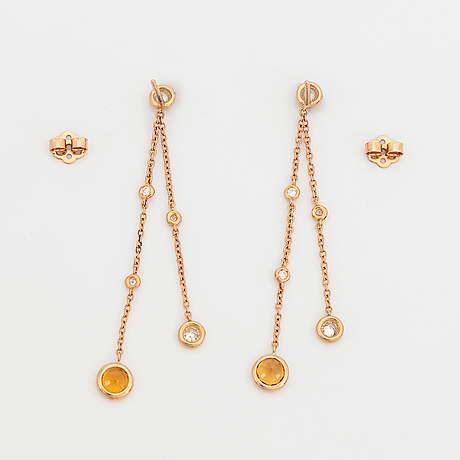 Yellow sapphire and brilliant-cut diamond earrings.