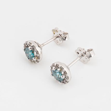 Blue colourtreated diamond earrings.