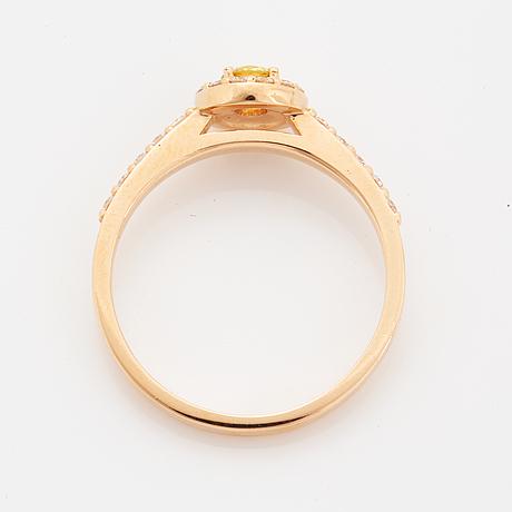 Brilliant-cut colour treated yellow diamond ring.