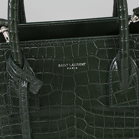 Yves saint laurent, a crocodile embossed green leather 'sac du jour baby' bag, 2018.