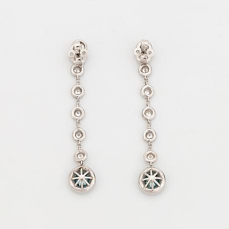 Brilliant-cut blue colour treated diamond and brilliant-cut diamond earrings.