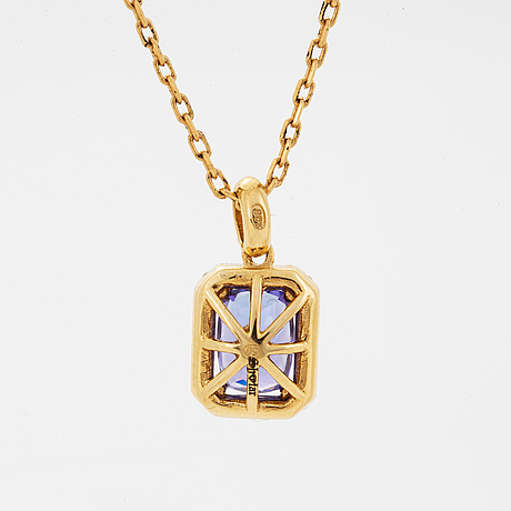 An 18k gold necklace set with a faceted tanzanite.