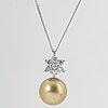 Cultured yellow south sea pearl and brilliant-cut diamond pendant.