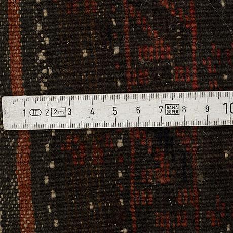 A rug, semi-antique baluch ca 183 x 101 cm.