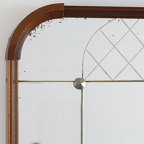 A mahogany mirror from glas&trä, hovmantorp, 1959.