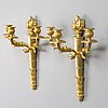 A pair of empire wall candelabras in gilt bronze from the late 19th century.