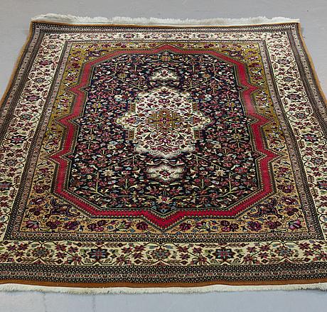 A rug, old qum, ca 216 x 140 cm.
