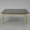 A 1960-70's brass and glass coffee table.
