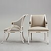 A pair of late gustavian early 19th century armchairs.
