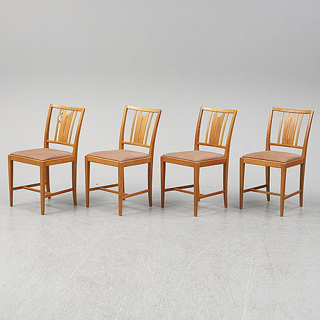 An oak dining table and four chairs by carl malmsten for bodafors. second half of the 20th century.