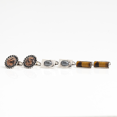 A set of three pairs of silver cufflinks with hematite, tigers eye and granite. turun hopea and osvald mättö.