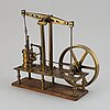 A brass steam engine, 20th century.