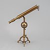 A table top telescope on tripod mount from the first half of the 20th-century.