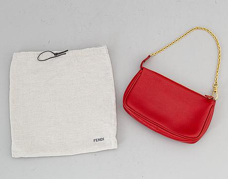 Fendi, a red hand bag.