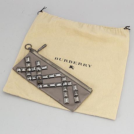 Burberry, a satin clutch.
