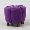 A 1940's table with pouf.