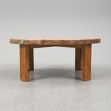 A pine coffee table by roland wilhelmsson. dated -71.