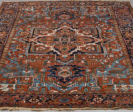 A rug, antique/semi-antique heris, 277 x 209.