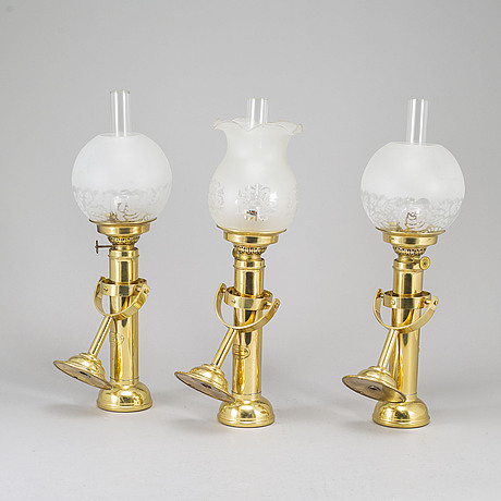 A set of three brass kerosene lamps gv harnisch denmark later part of the 20th century.