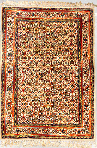A rug, old tabriz, signed, ca 247 x 173 cm.