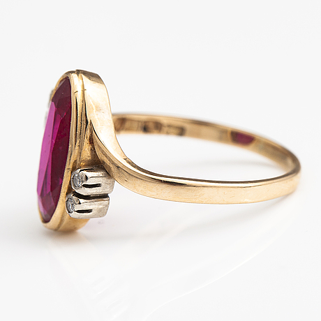 A 14k gold ring with a synthetic ruby and ca. 0.04 ct of diamonds. finland 1983.