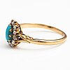 A 14k gold ring with a turquoise and rose cut diamonds.