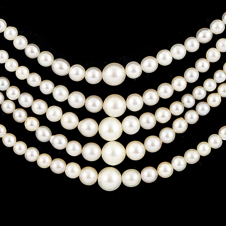 Diamond clasp cultured pearl necklace five rows.