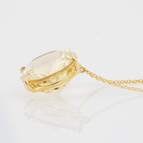 Yellow gold and heliodor pendant.