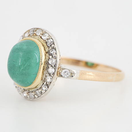 Cabochon-cut emerald and rose-cut diamond ring.