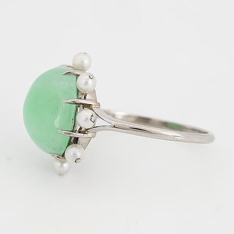 Cabochon-cut jade and pearl ring.
