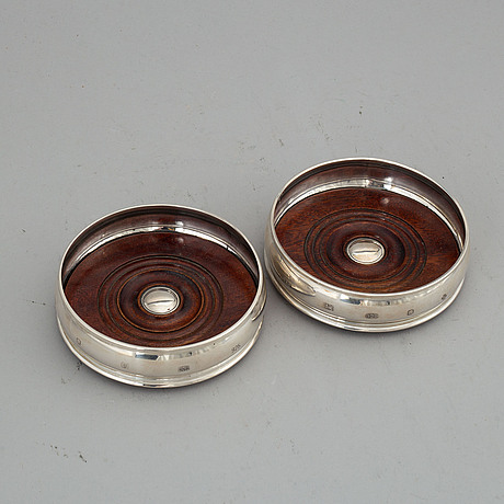A pair of silver coasters, mark of harrison brothers & howson ltd, london 1998-2000.