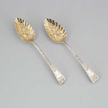 A pair of silver serving spoons, london 1796 and 1802.