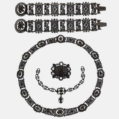 A berlin steel and iron parure comprising a necklace, two bracelets and a brooch.