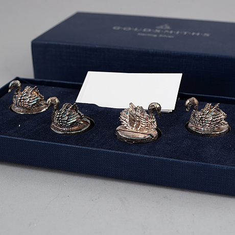 A set of four table-card swan holders, silver, england.