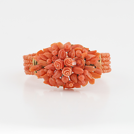 Carved coral bangle.