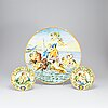A large majolica 'istoriato' dish and two plates, 20th century.