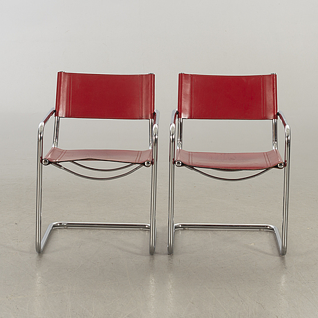 A pair of 20th century later part  armchairs.