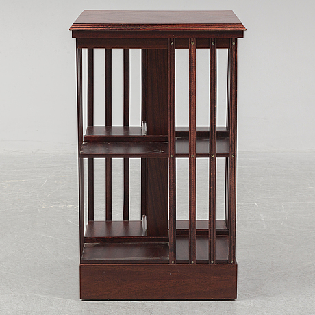 An end of the 20th century mahogany revolving book dance.