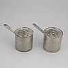 A pair of saucepans from tullgarns castle dated 1851.