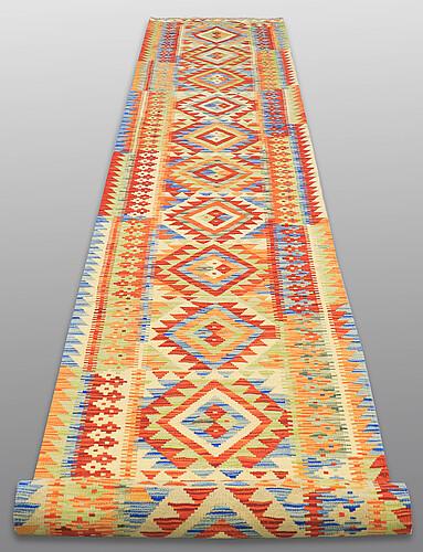 A runner, kilim, ca 610 x 85 cm.