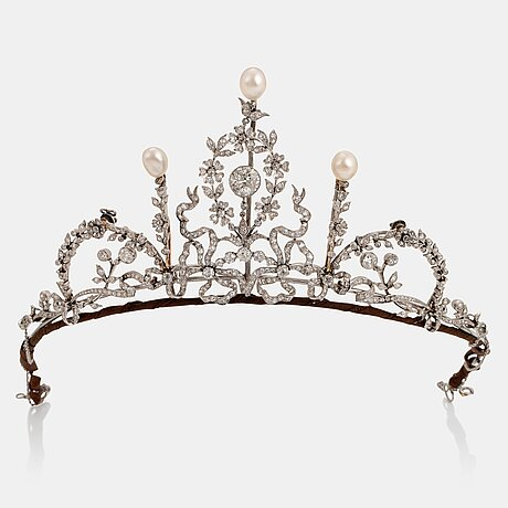 A platinum tiara/necklace combination set with old-cut diamonds and pearls.