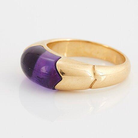 An 18k gold bulgari ring set with an amethyst.