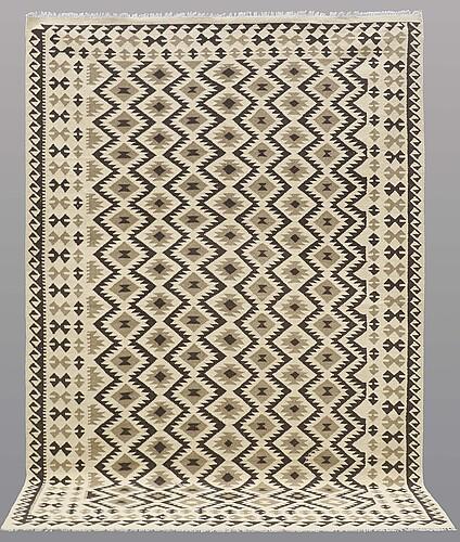 A carpet, kilim, ca 296 x 203 cm.