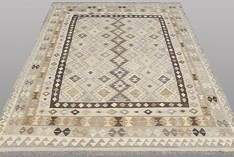 A rug, kilim, ca 299 x 205 cm.