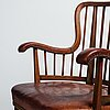 Otto schulz, a swedish modern stained beech and cognac coloured leather armchair.