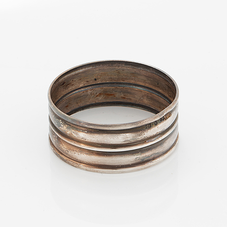 A silver napkin ring by cf carlmand.