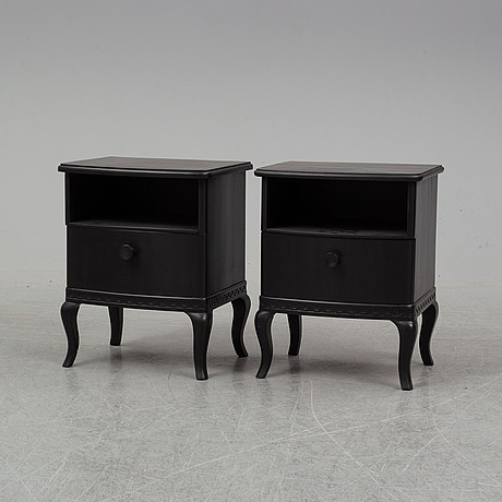A pair of bed tables.