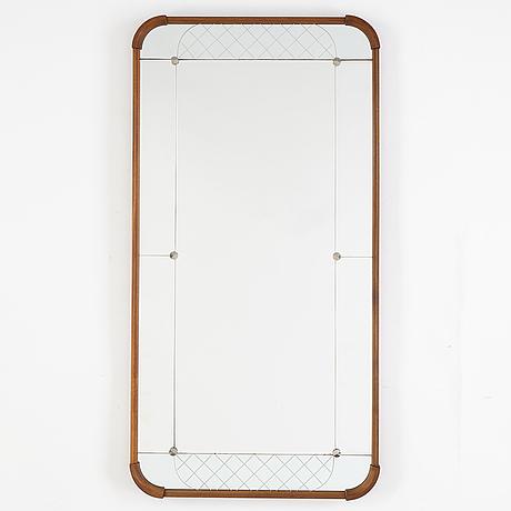 A teak veneered mirror.